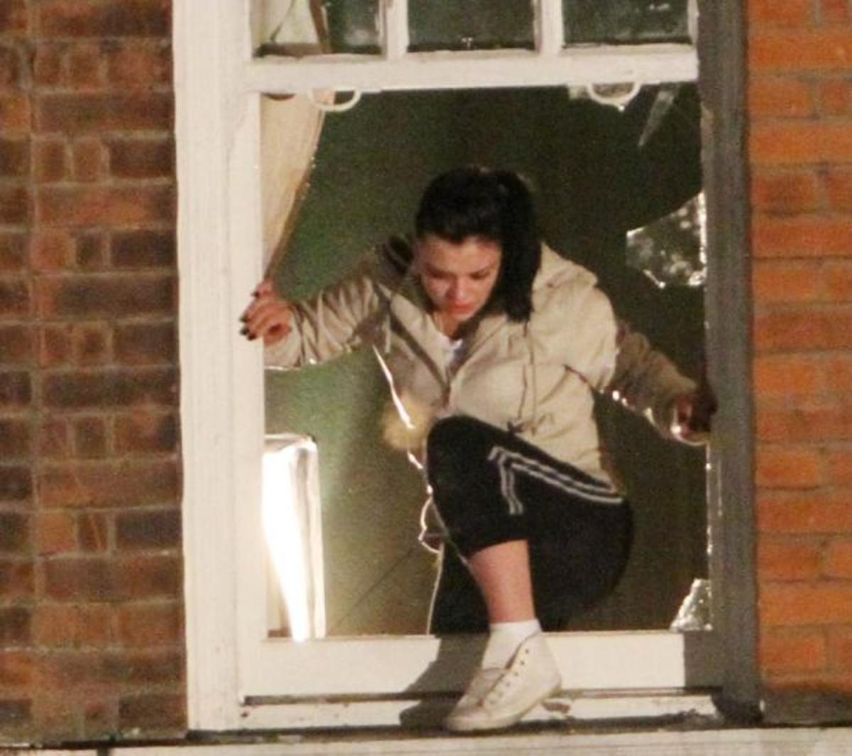 but her only way out is to smash her way through a window and ........