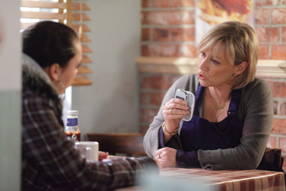 later in the Cafe, Carol sees Whitney with a phone that has been given to her by Rob and assumes she has stolen it