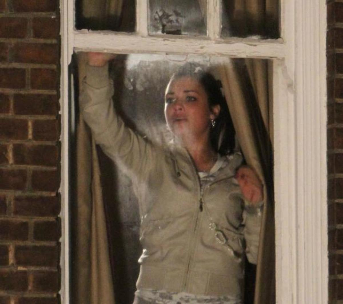 while at the party a scared Whitney desperately searches for an escape route