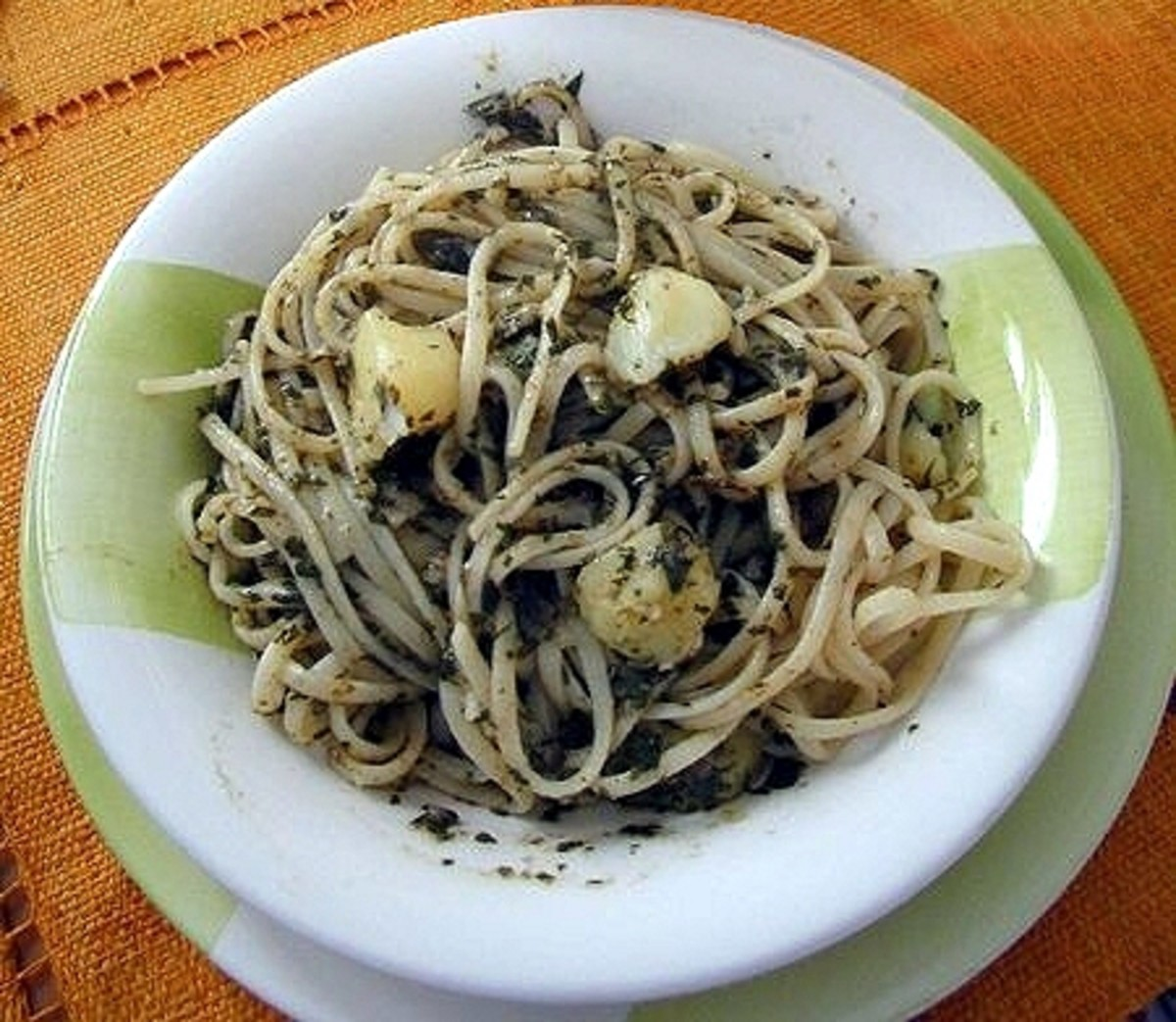 A Genoese sailor might eat pasta with pesto  depicted here because it was local food