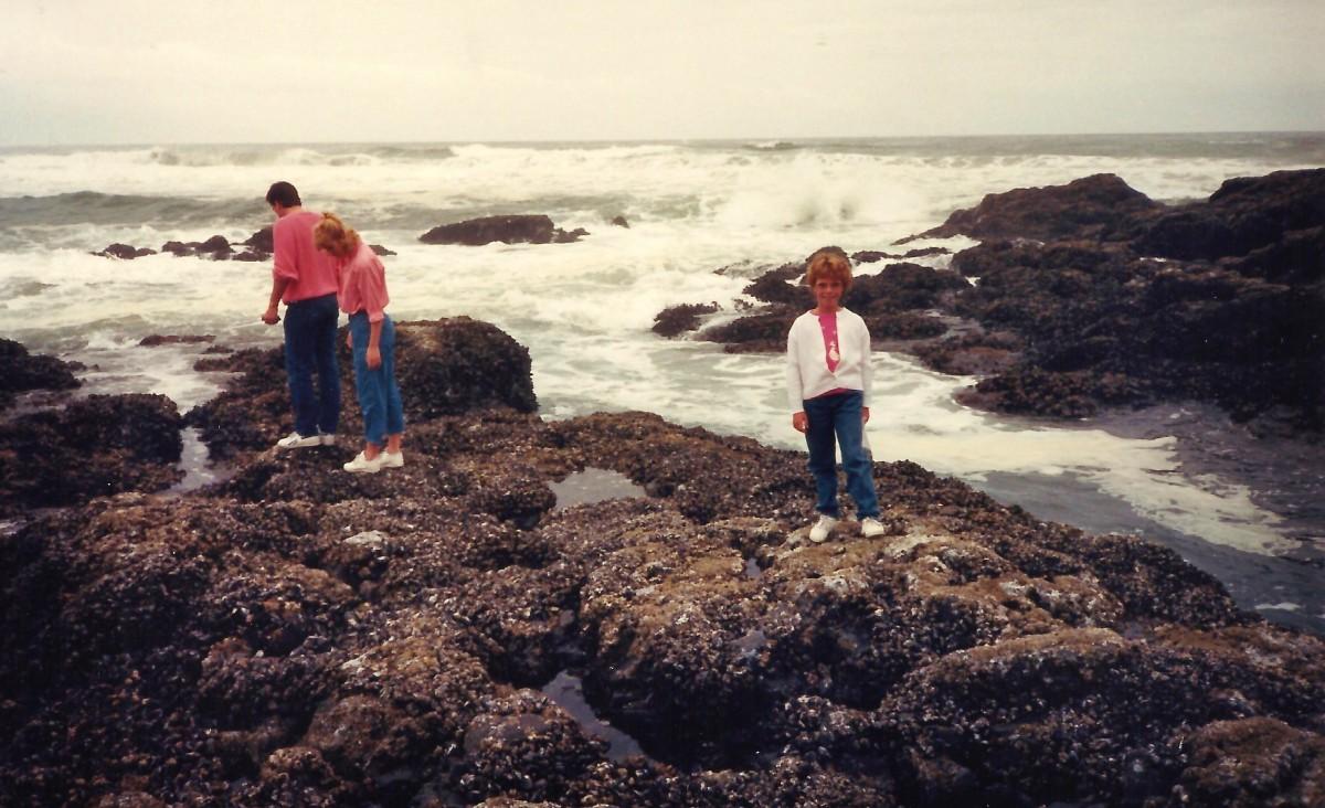 Walking along the barnacle encrusted rocks at Lone Ranch.