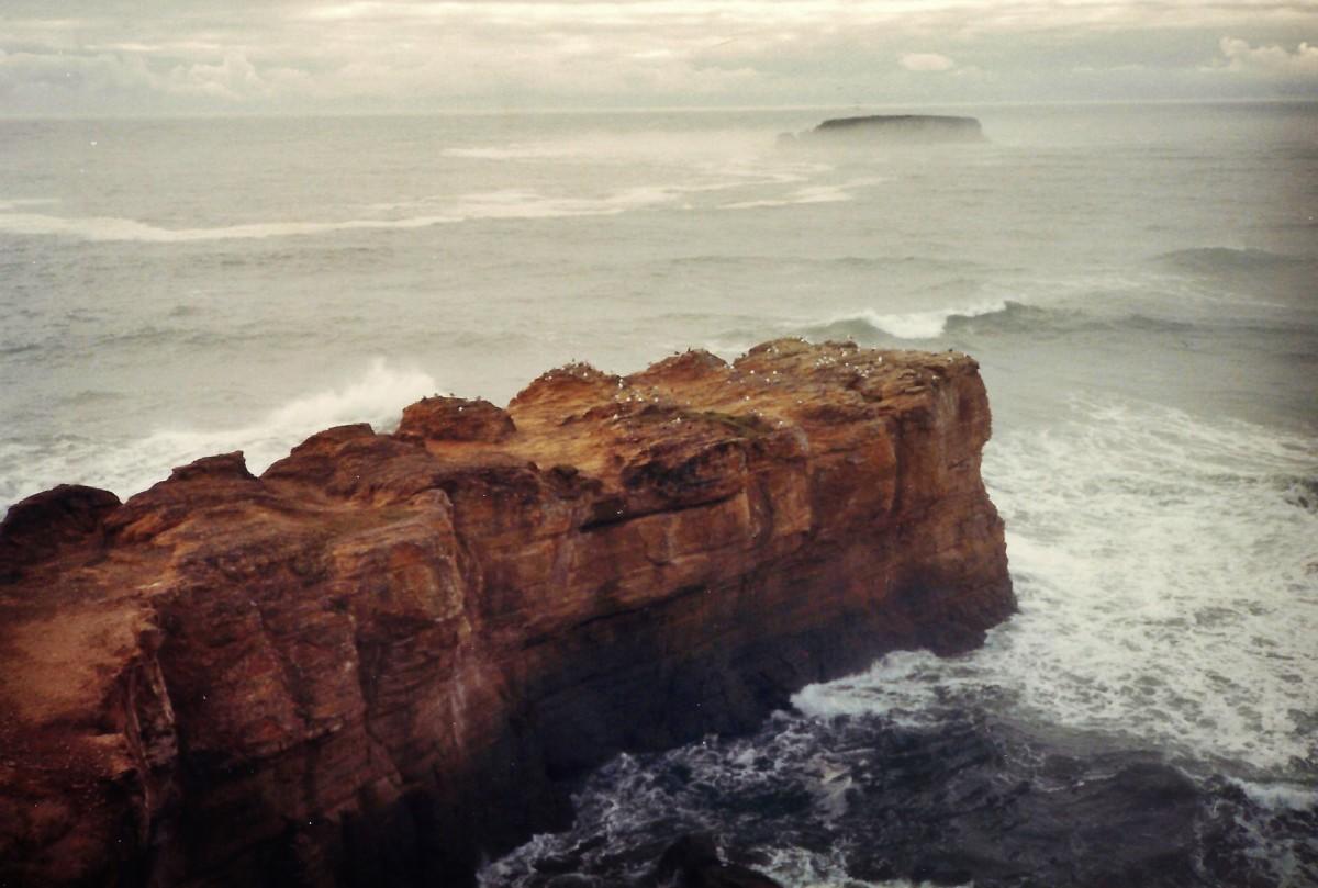 Oregon coastline - rock jutting out into ocean