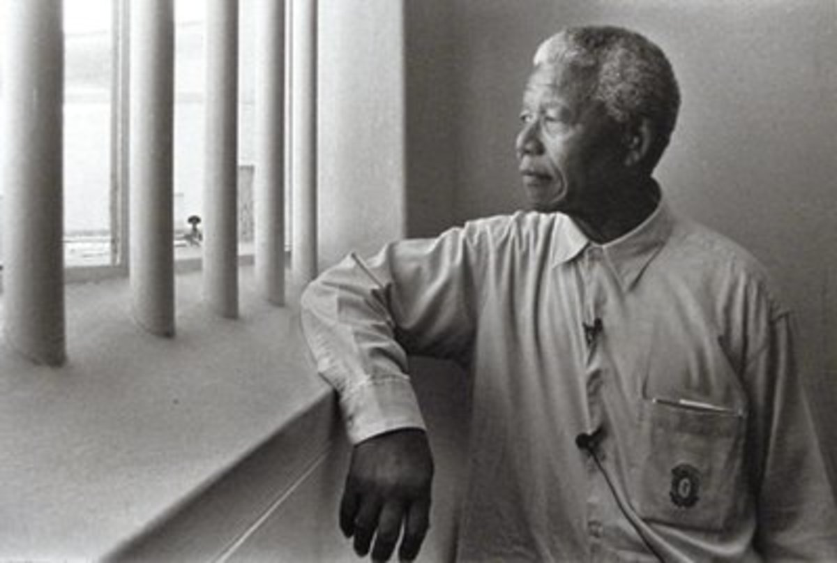 Nelson Mandela staring out of the window of the cell he occupied while he was imprisoned on Robbin Island.