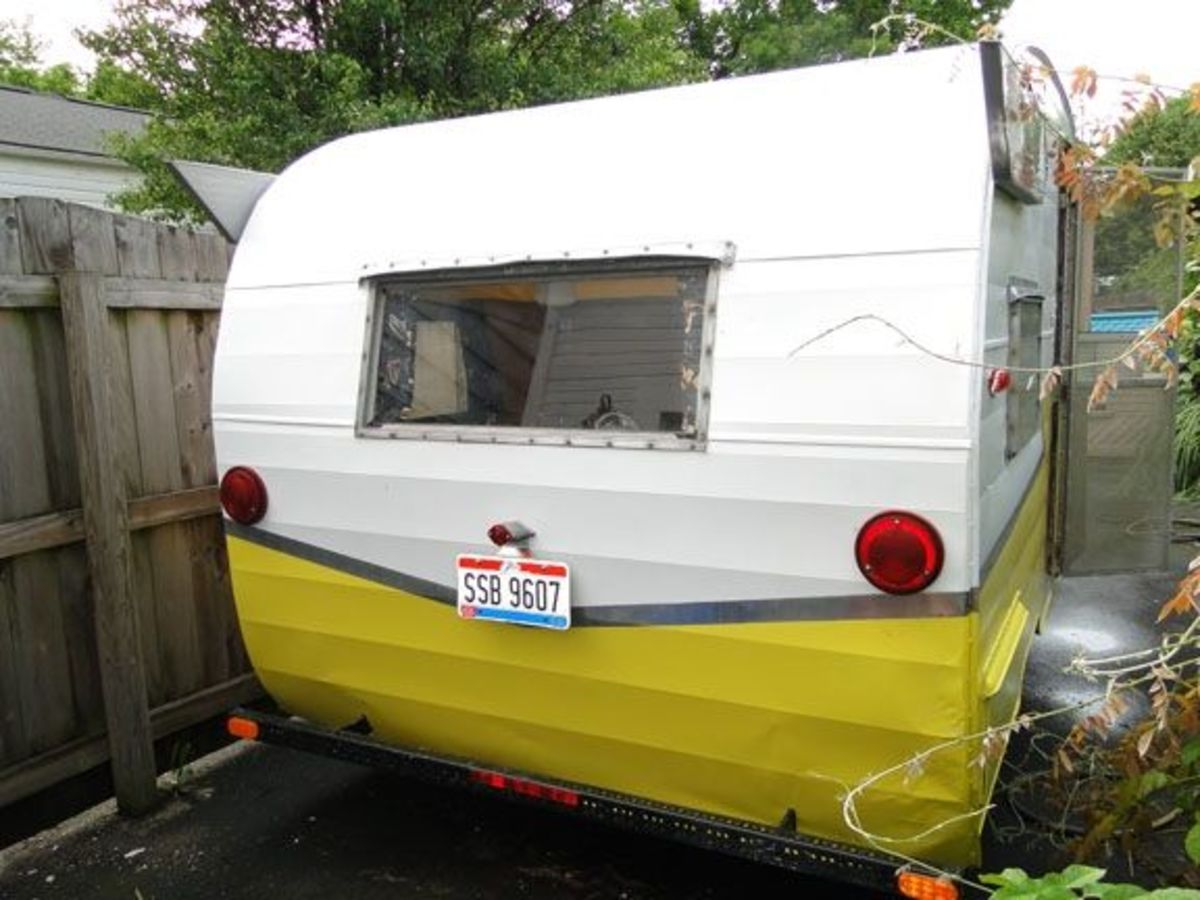 "Glamour camper exterior after our DIY ""$50 Paint Job"" and polish. John Deere yellow mixed 1:1 with White. Wings & stripe polished with Mother's Polish."