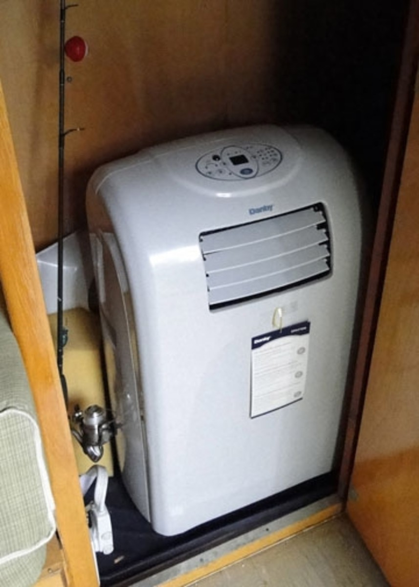 Danby portable air conditioner rigged into former bathroom and venting below keeps our canned ham cool.