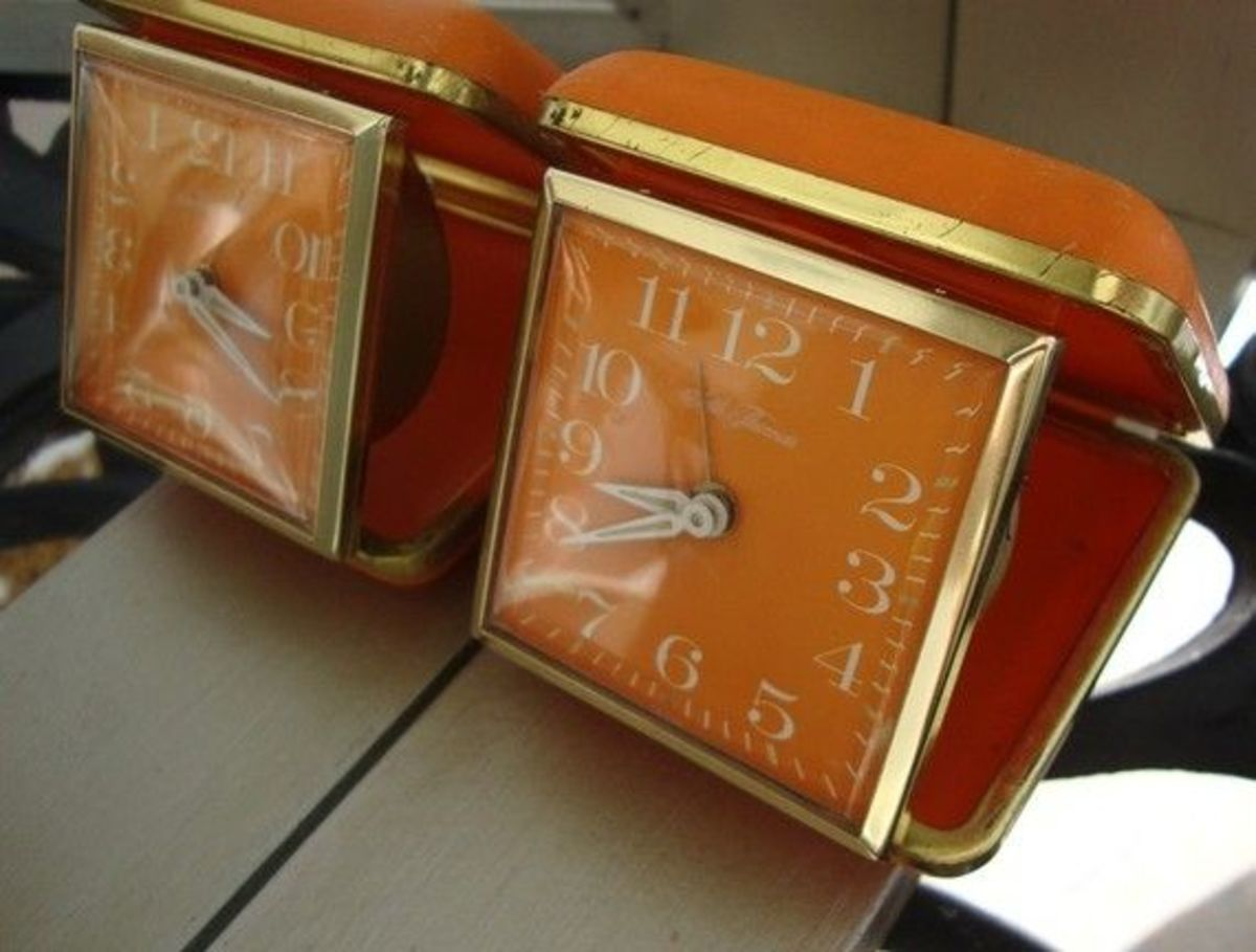 Orange Travel Clocks. How perfect!