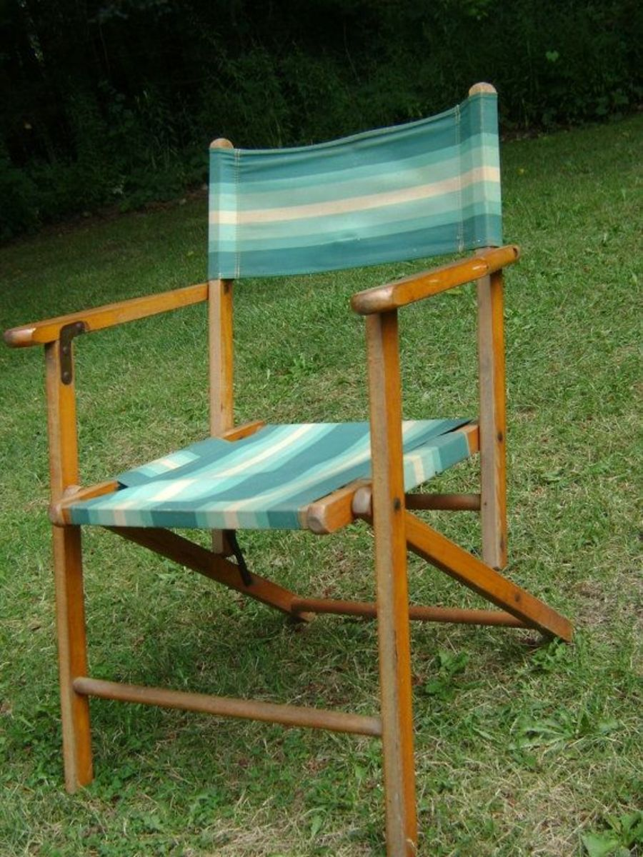 1940's style wood and canvas camp chairs are comfortable, collapsible and stylish. Update it with Sunbrella fabric in your color palette