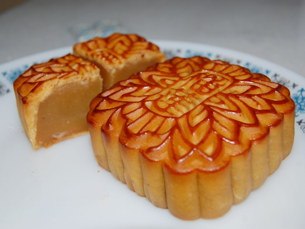 "Durian Lotus Seed Mooncake. Traditional mooncakes have an imprint on top consisting of Chinese characters. Here are the Chinese characters for  ""Durian"""