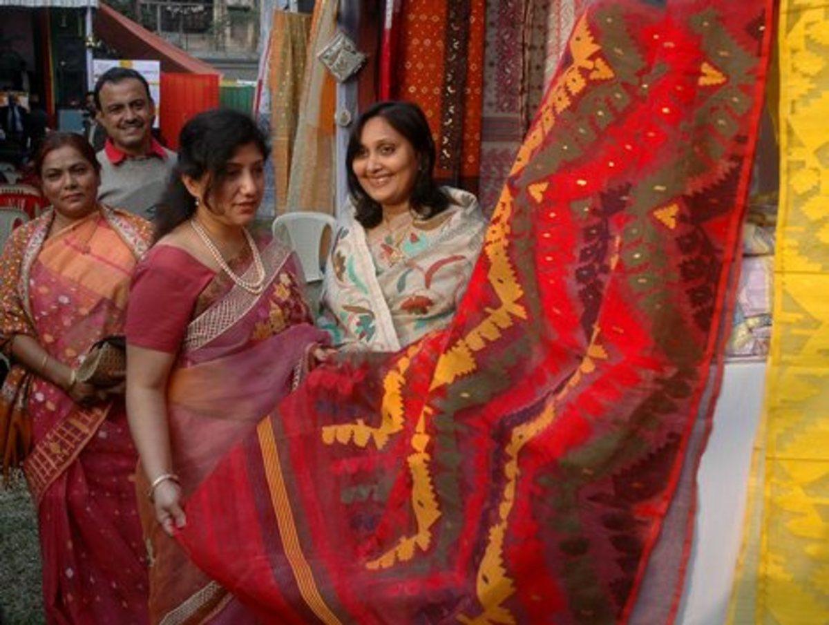 Beautiful Jamdani saree in red, green and yellow for holud