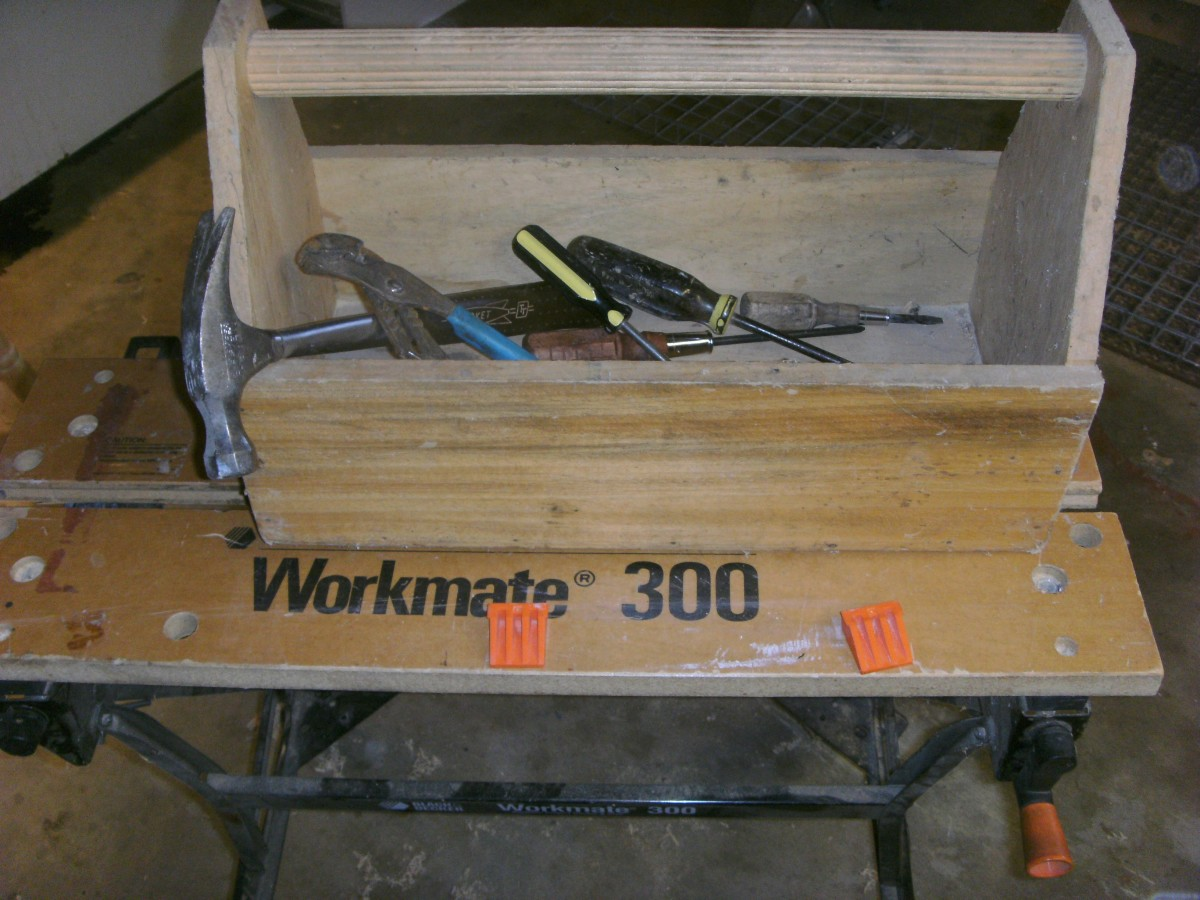 Toolbox made by cub scouts and used for 30 years.  Note the Workmate workbench it is sitting on.