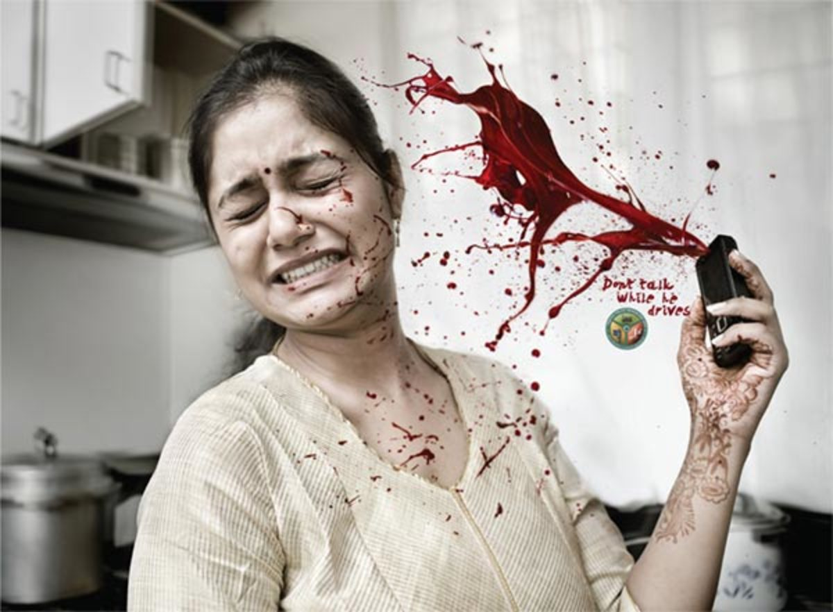 """Don't talk while he drives"". An outdoor advertising campaign using disturbing photography by Bangalore Traffic Police"