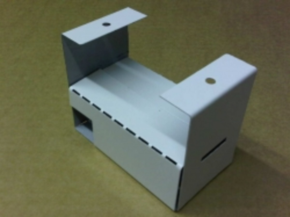 Hybrid CNC bent and hand folded sheet metal component for the lighting industry