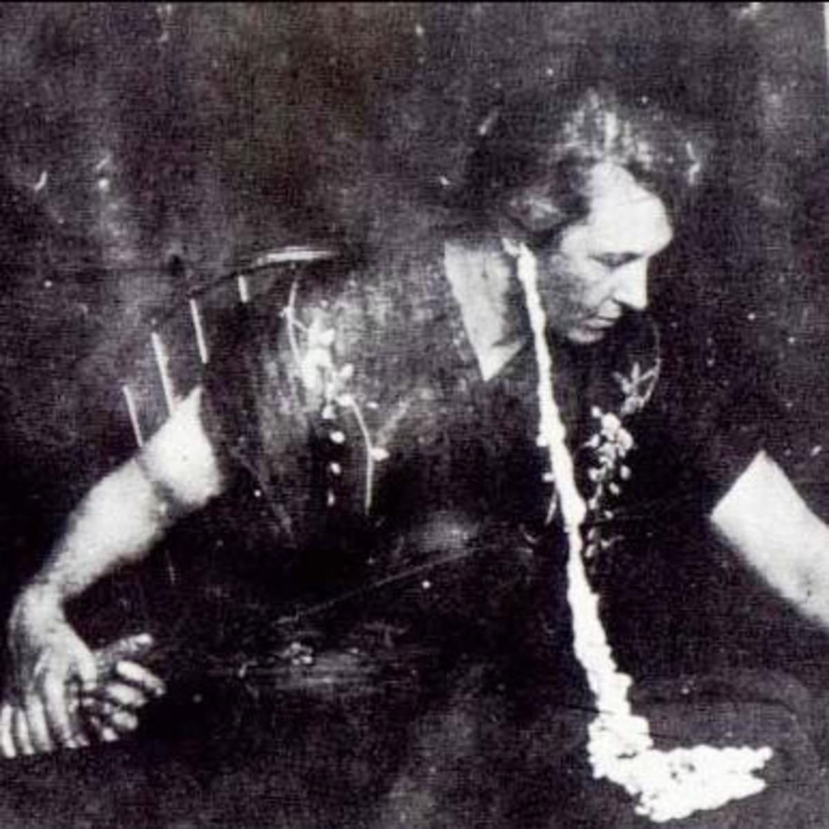 Antique photograph of medium Mina Stinson Crandon exuding ectoplasm