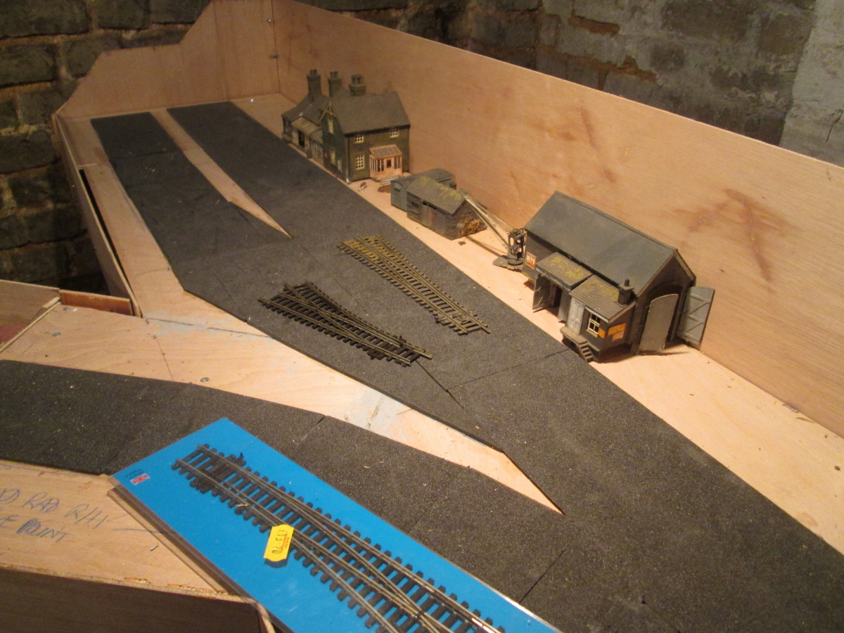 The furthest reaches of Unit 6, with foam underlay (from Carrs) where track is to be laid. Platform and structure edges will be based on the foam. Buildings 'recycled' from the ;Kirkrigg' layout.