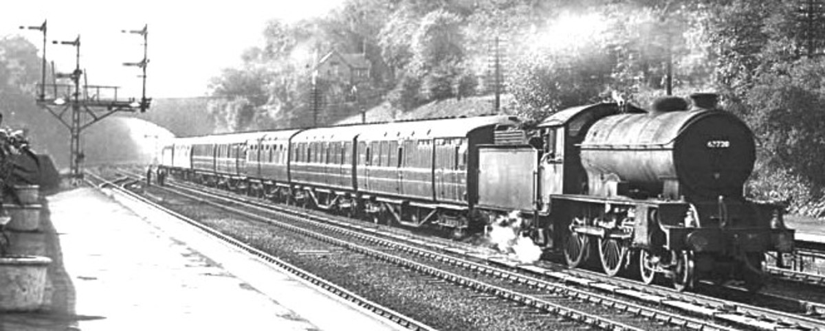 Hessle near Hull. D49/1 62720 'Cambridgeshire' with suburban passenger working. Cinder ballast. Note also late LNER type triple doll bracket signal at the left .