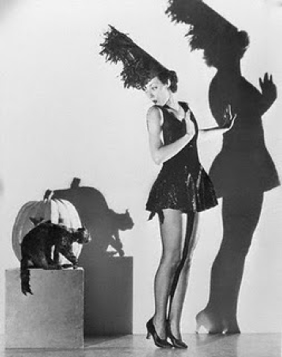 black and white vintage photo of Halloween cat with girl in dance costume
