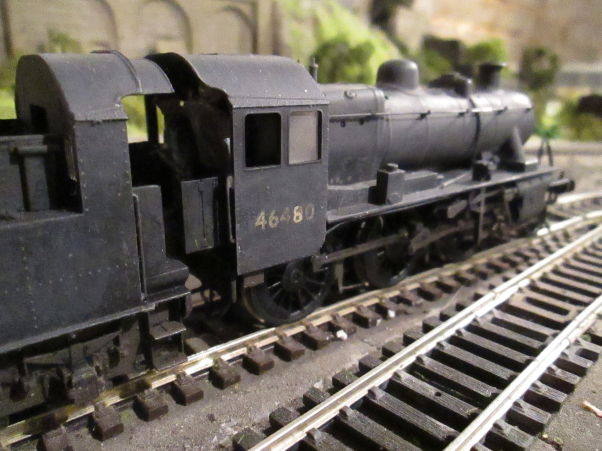 Ex-LMS 2MT 2-6-0, class nicknamed 'Mickey Mouse' ran on branch lines with light goods, occasional passenger workings - a weathered Bachmann model with lost wax cast vacuum pipes and Jackson screw couplings. Hand-painted white-metal crew