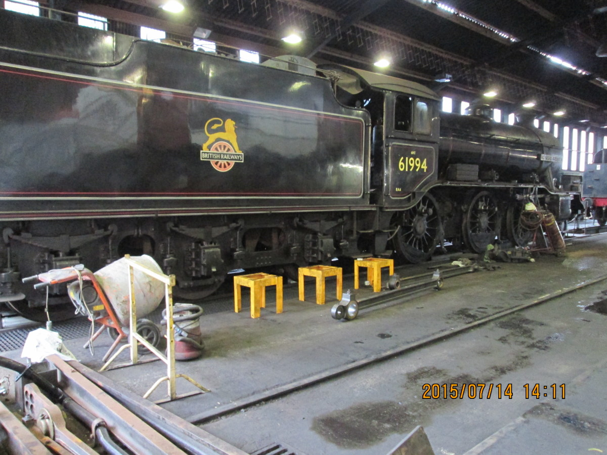 The real thing, one-time 3442 'The Great Marquess', now in BR guise as 61994 with early BR lion on wheel crest under ownership of James Cameron, in NYMR Grosmont shed
