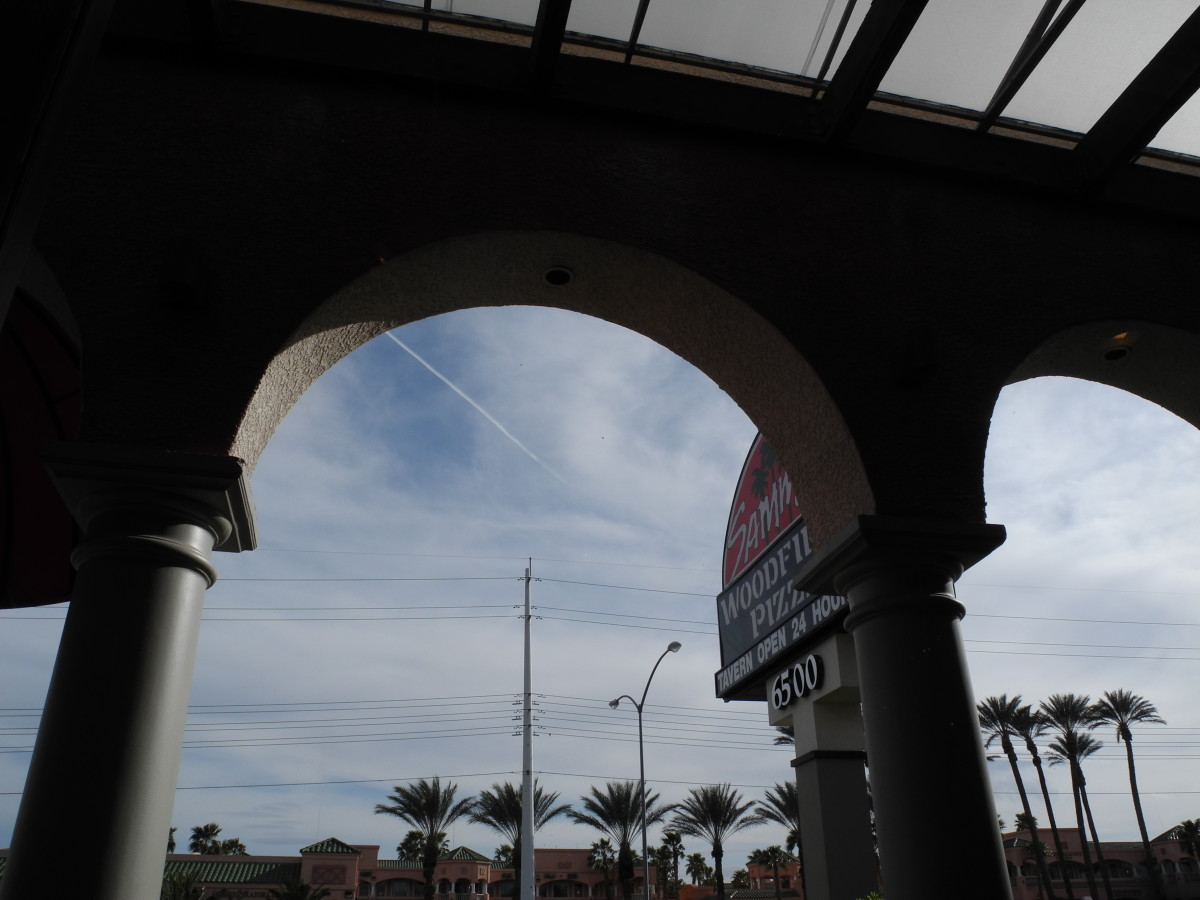 """Chemtrails caught """"in action"""" while dining at Sammy's Pizza in Las Vegas.  (Window View)"""