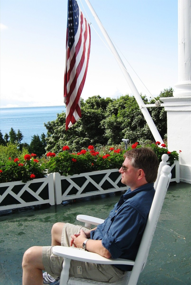 Doug enjoying the view from the porch of the Grand Hotel