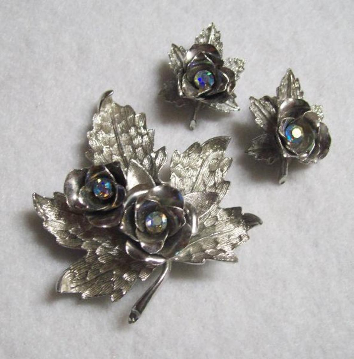 A Coro silver leaf pin and earring set.