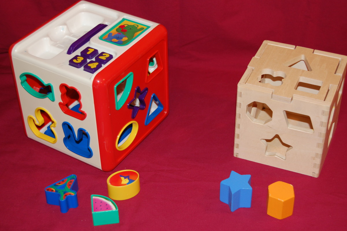 Goodwill sorter on the left with pieces missing; Melissa and Doug sorter on the right