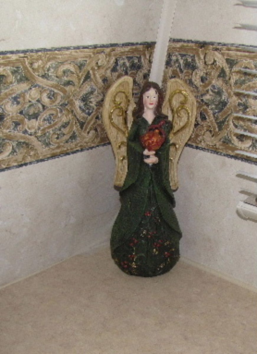 This diminutive angel was the ultimate find for a frugal decorator - someone gave her to me (free!). However, she matched the trailer wallpaper so precisely that I knew she was meant for mom, not me.