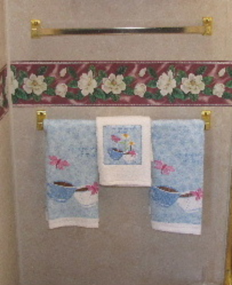 Once we've enjoyed our family Christmas, we pack the seasonal towels. Mom's trailer is decorated in a teapot/teacup theme in honor of her lifelong hobby of collecting teacups.
