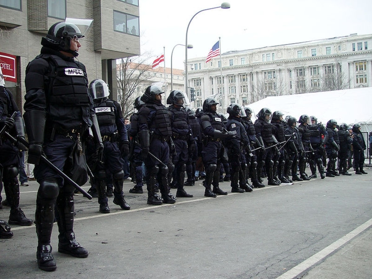 Police in riot gear blocking a checkpoint into the parade route at Bush's 2nd inauguration, Washington DC. 20 January 2005