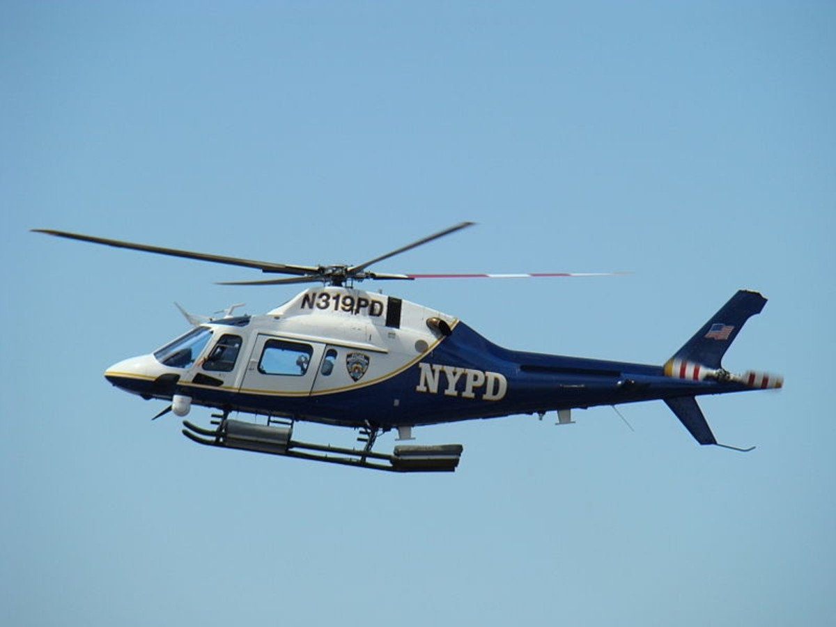 NYPD helicopter patrolling New York City. 29 May 2008. Barretta .50 caliber machine guns have been mounted on some NYPD helicopters to shoot down terrorist aircraft.
