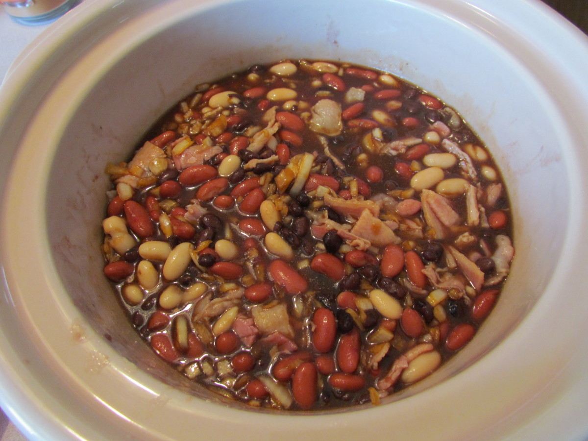 The beans will look soupy to start.  Don't panic!  They will boil down and soften up and the brown sugar and molasses will take over!