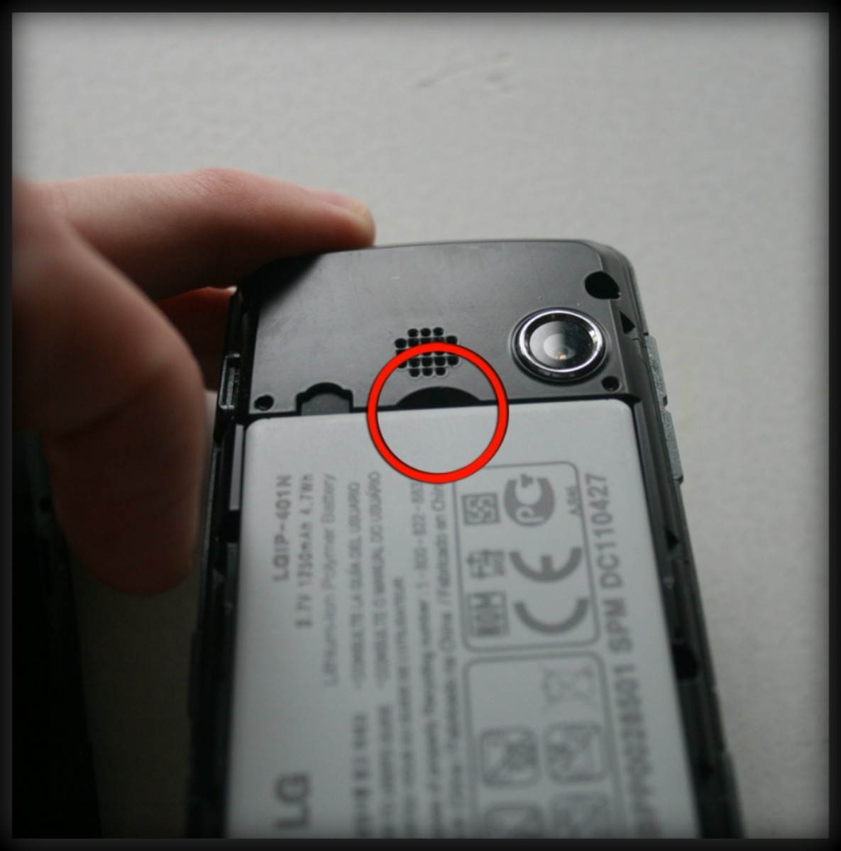 On the LG Rumor Touch there is a small cutout for using your fingernail to remove the battery. Most phones will have some sort of notch to all you to slip a fingernail or a small object to remove the battery.