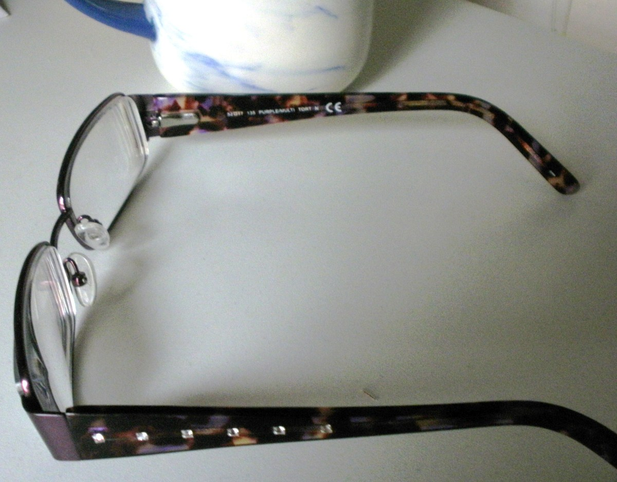 These stylish glasses with encrusted jewels are hiding a dark secret.  They are creating a blind spot in your viewing area.