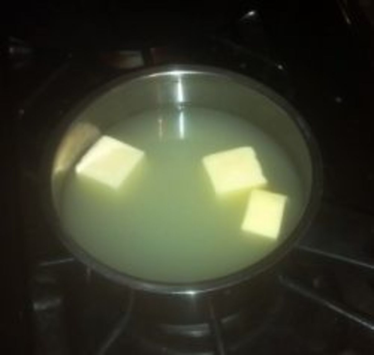 Warm up whey and water.  Melt the butter into the warm liquid.