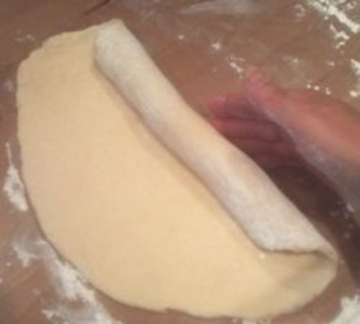 Roll the dough into a cylinder shape.