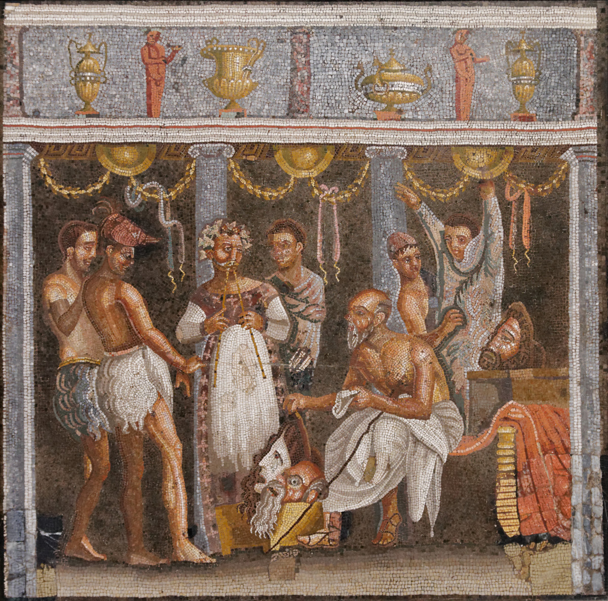 A Roman mosaic depicting a dramatic performance in a Roman house.