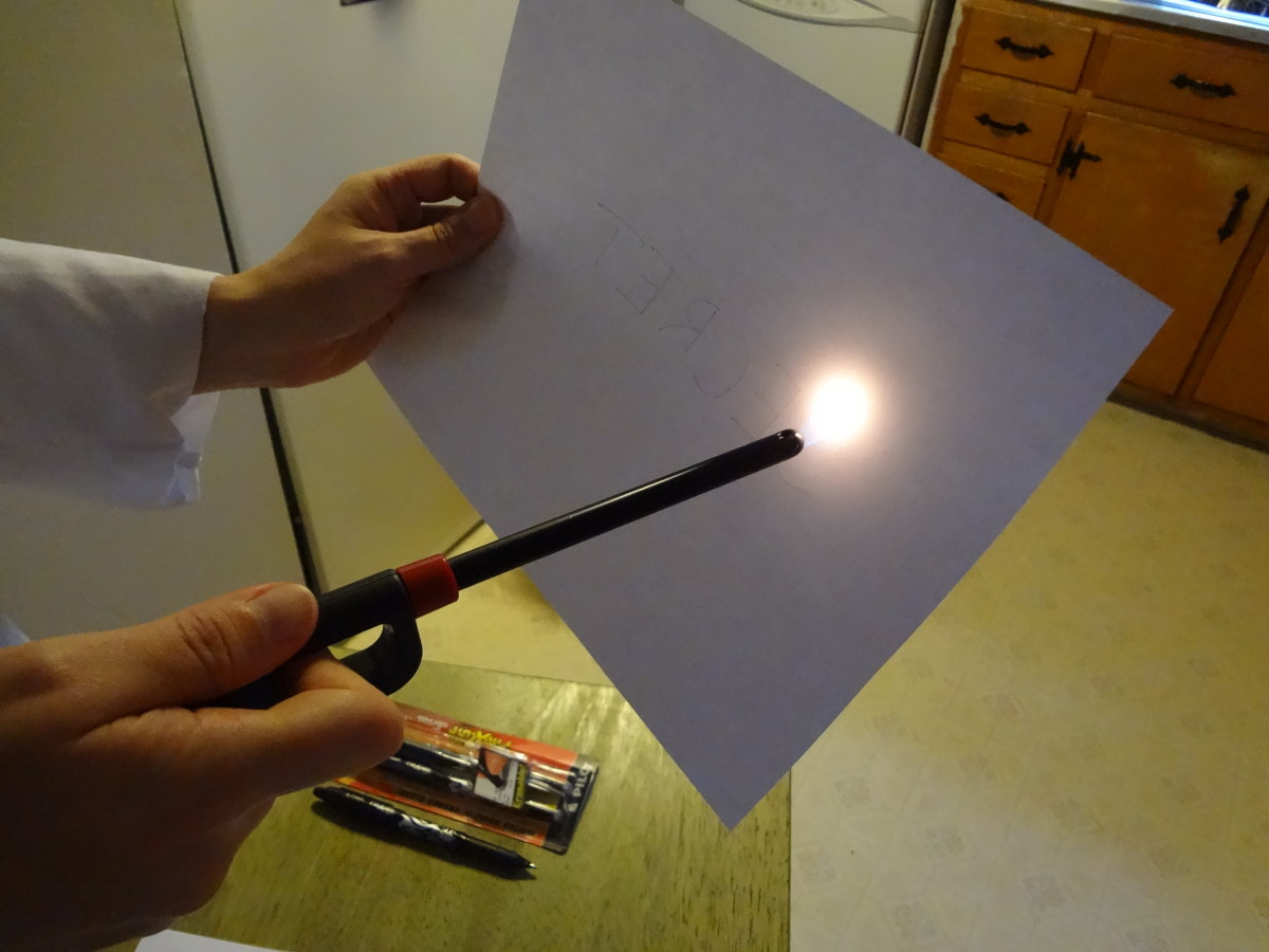 Move a lighter or candle back and forth across the message to make it disappear.