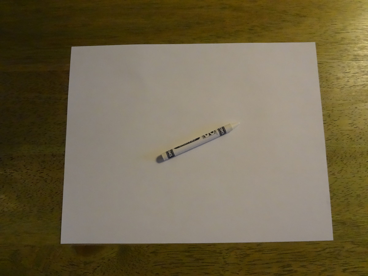 Messages written on white paper in white crayon are invisible.