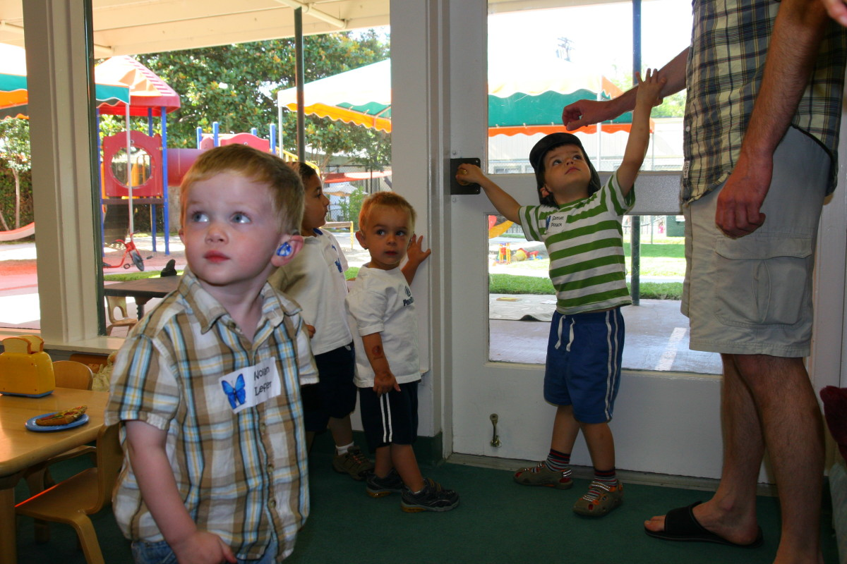 The John Tracy Clinic is a non-profit organization that offers free correspondence courses, summer school sessions, and hearing aid assistance to children with hearing loss.