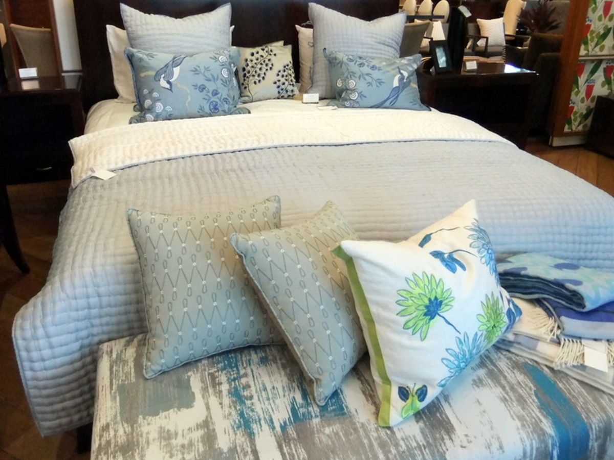 15. In this bedroom, the color scheme for the decorative throw pillow matches, but in different fabric design