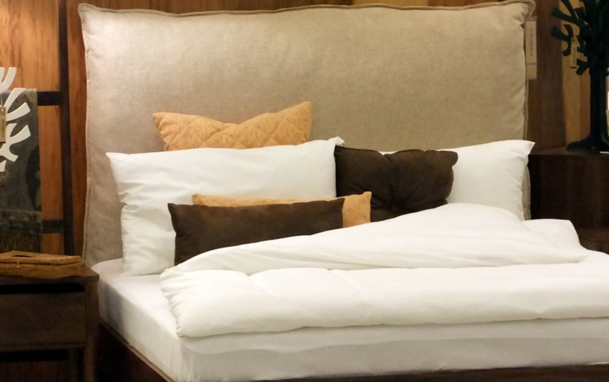 14. The dark brown throw pillows add depth to the overall color scheme