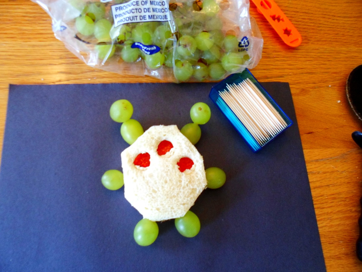 Use green grapes and toothpicks to create arms, legs, and antennae.