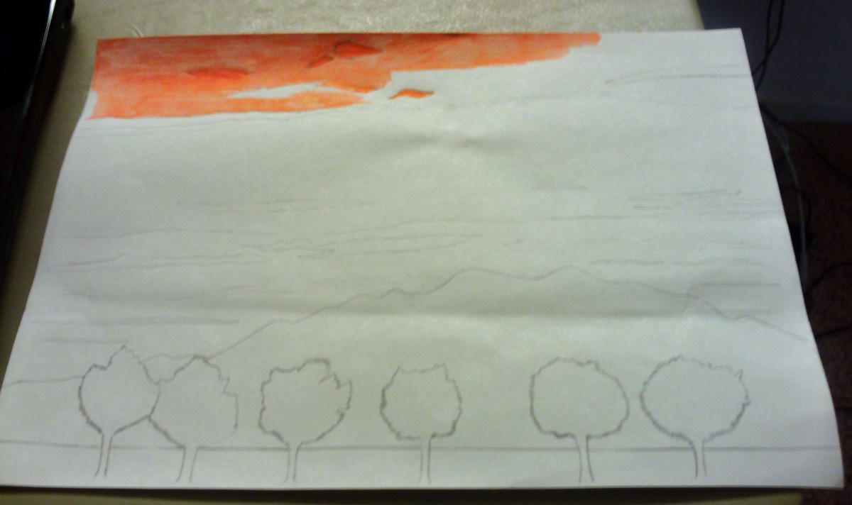 Here I am beginning to color in the orange parts of the sunset sky.