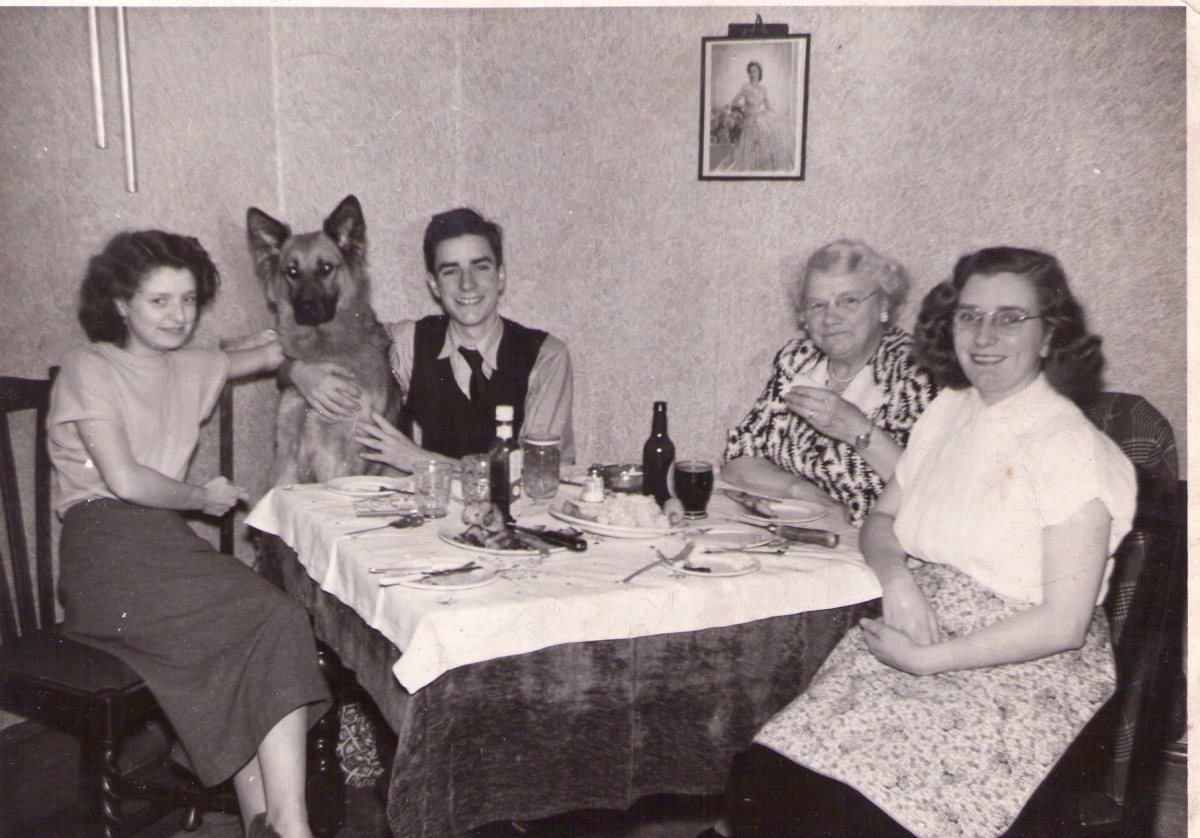 My Dad and his German Shepherd, Flash - quite at home at the tea table!  Flash was named by my Dad, aged 11, for the popular film character Flash Gordon.
