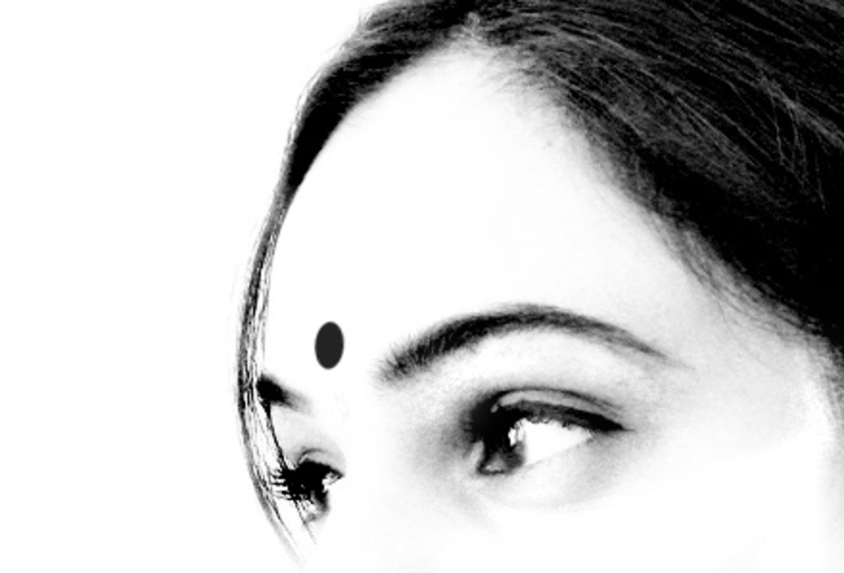 Black dot on the forehead is believed to cure one that has received the evil eye.