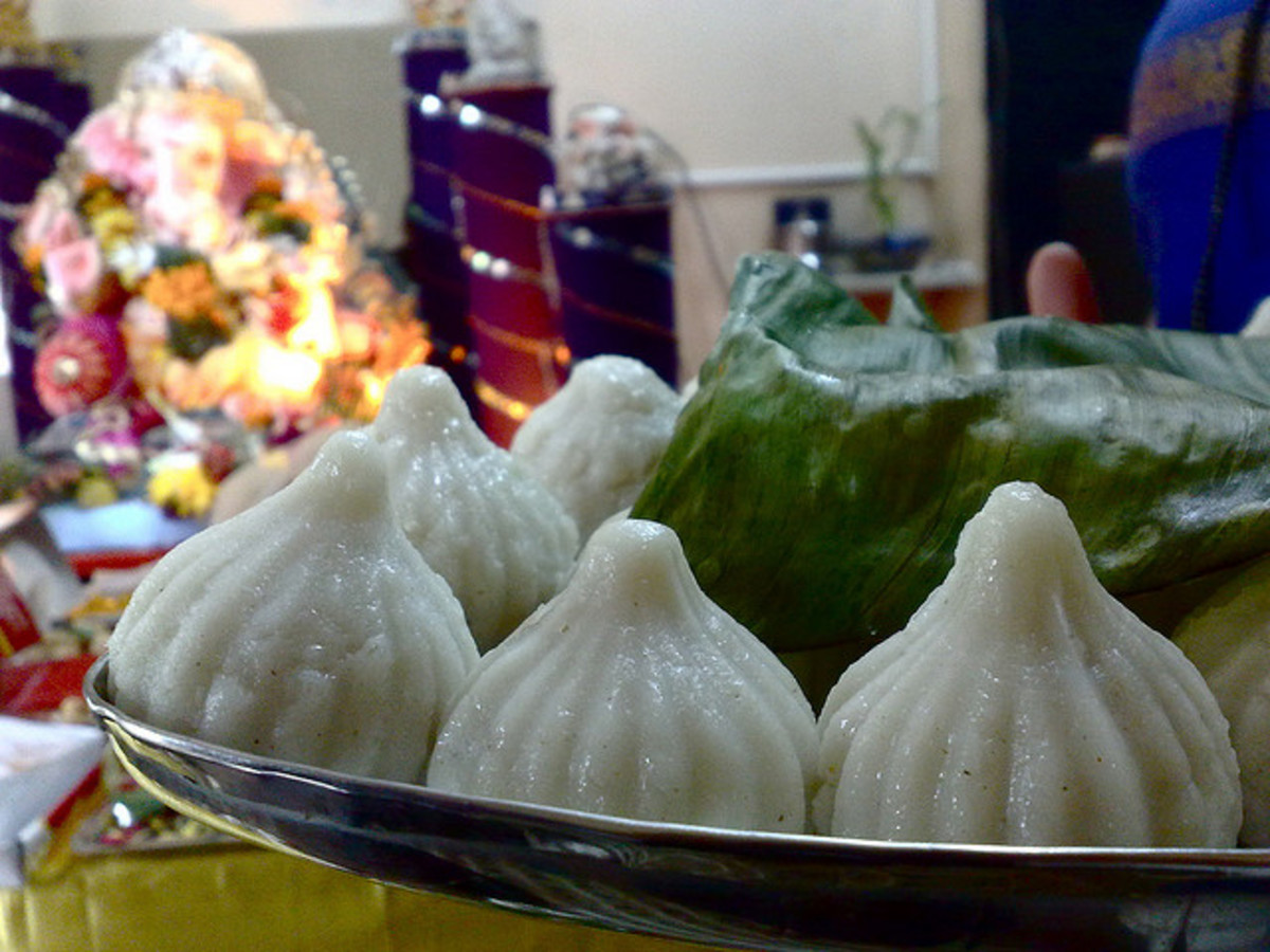 modaks ,the white sweets in the forefront