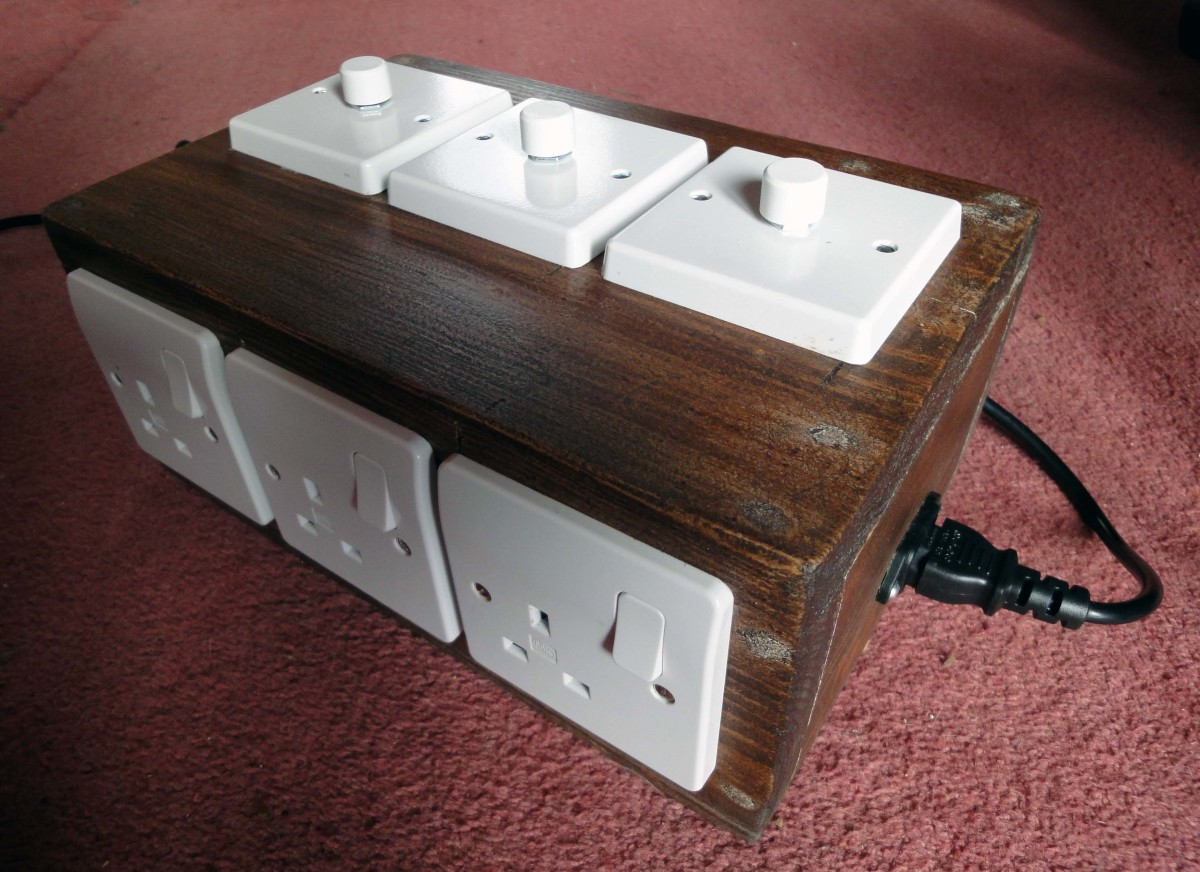 Holes cut for light switches with SoniCrafter in this Dimmer Lighting Unit Control Box