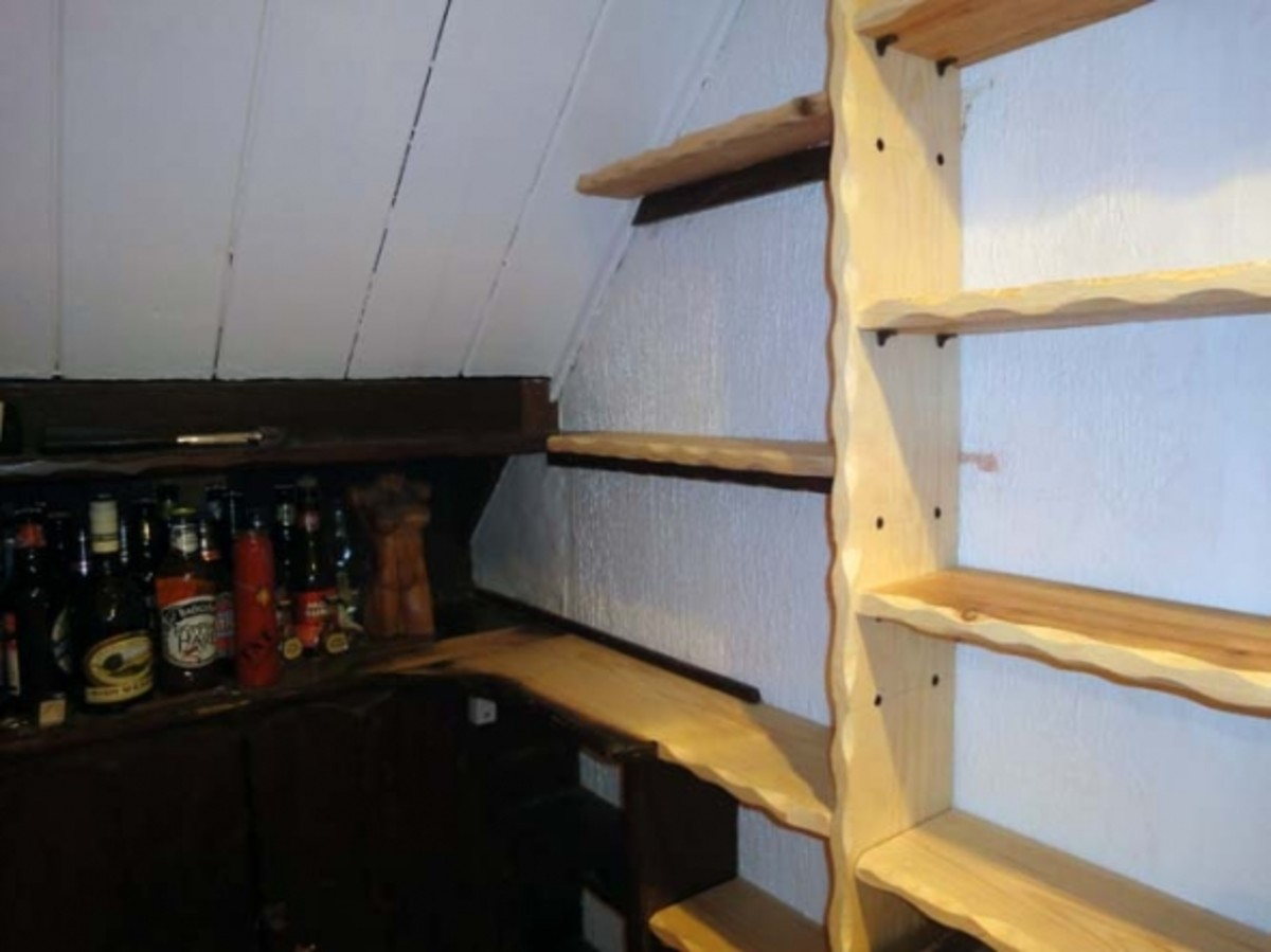New shelving butted against original shelves.