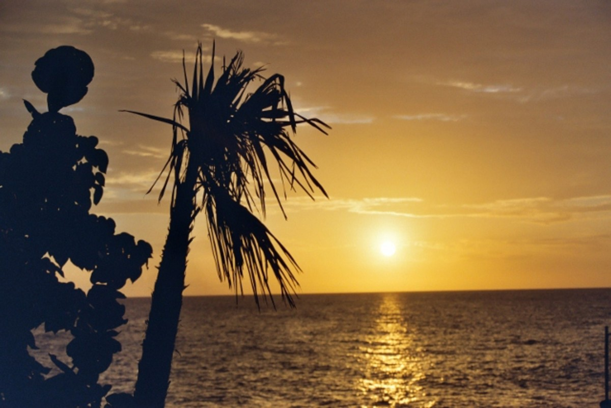 """The sunset is amazing on the beach at """"Jackie's on the Reef"""" spa resort in Negril, Jamaica."""