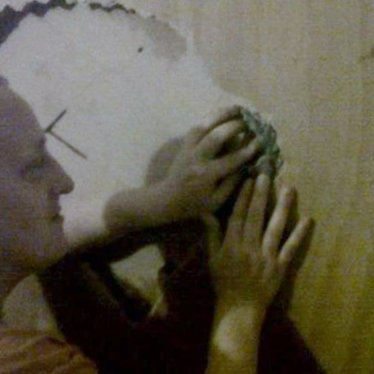 Me filling the hole with crumpled newspaper soaked in wallpaper paste.